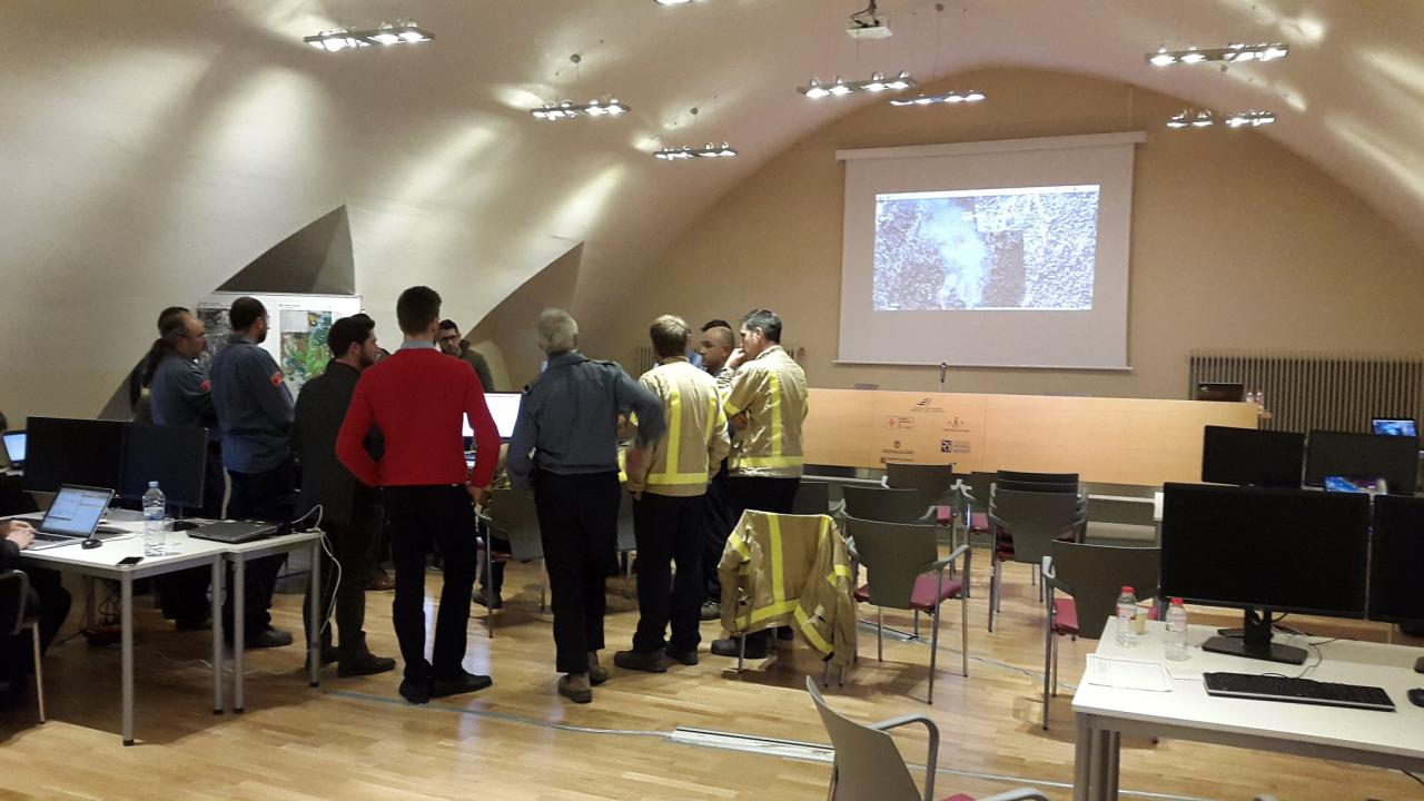 Firefighter briefing in the situation room of the Forest Sciences Centre of Catalonia (CTFC) in Solsona