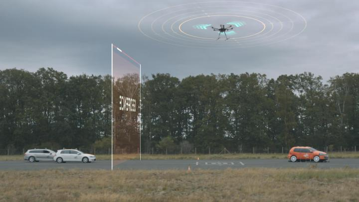 The automated vehicles create a digital barrier so that the drone can land safely.